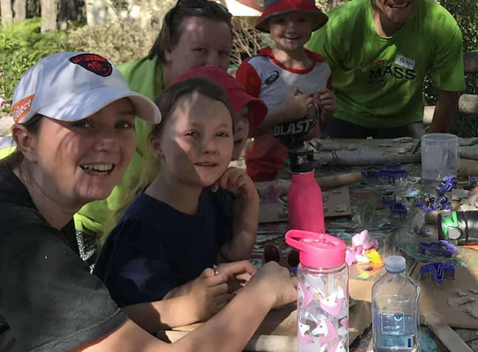 children and staff on a family camp